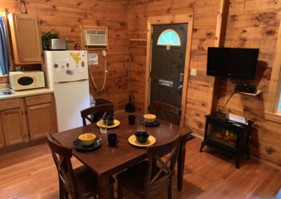 Mountaineer Cabin - Dining and Fireplace
