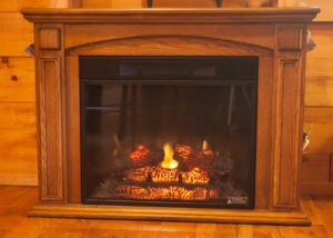 Vacation Lodges in West Virginia | Logs Burning in a Fireplace