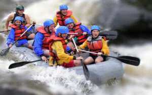 Vacation Lodge Activities | People Rafting in Water